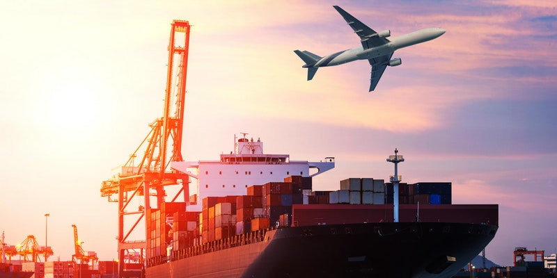 Airplane over shipping container